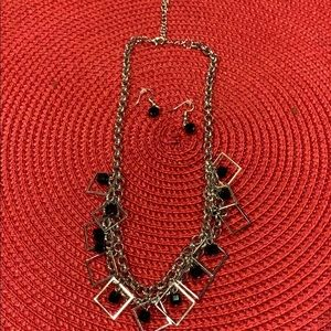 Silver and black necklace and earrings